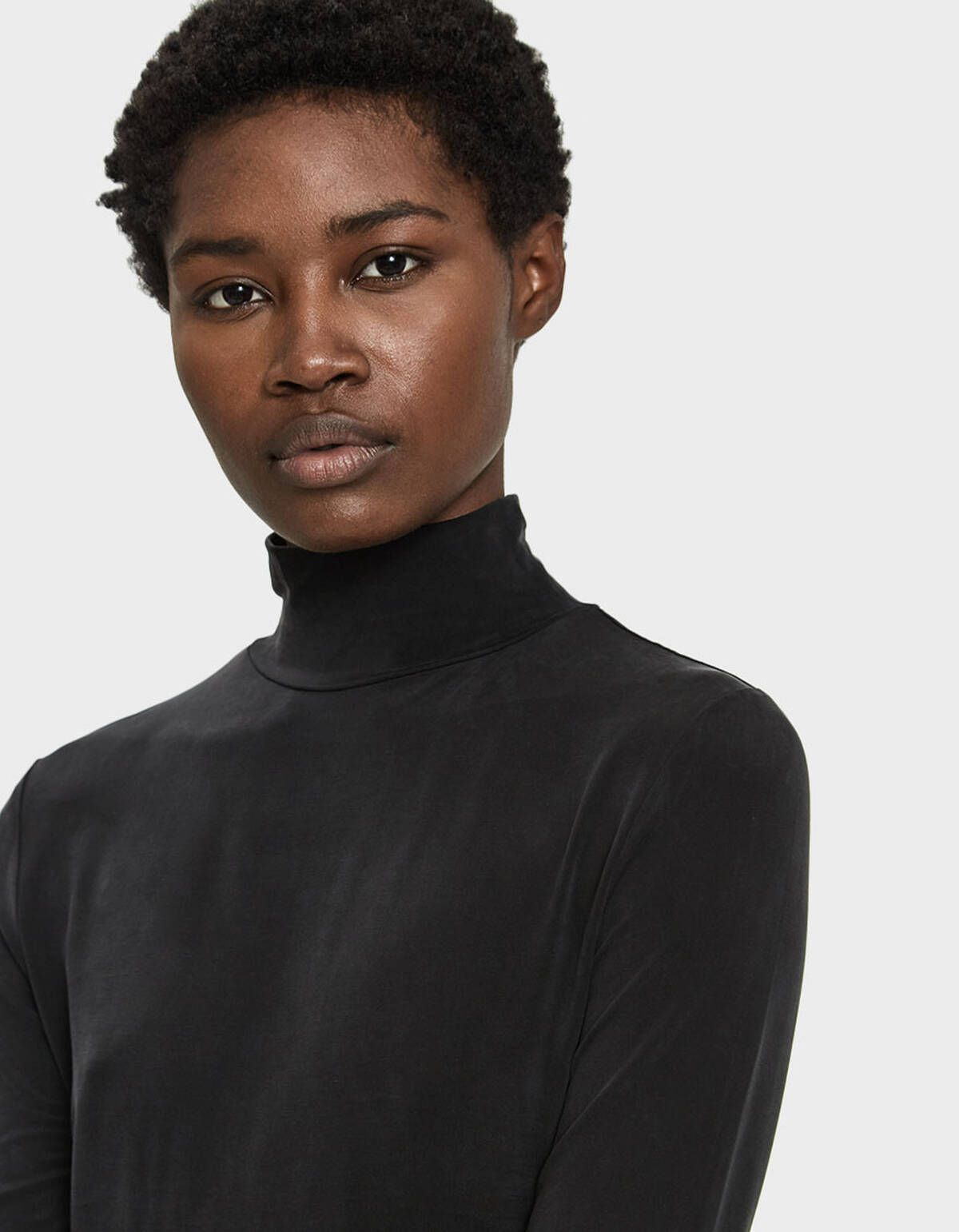 black mock-neck top