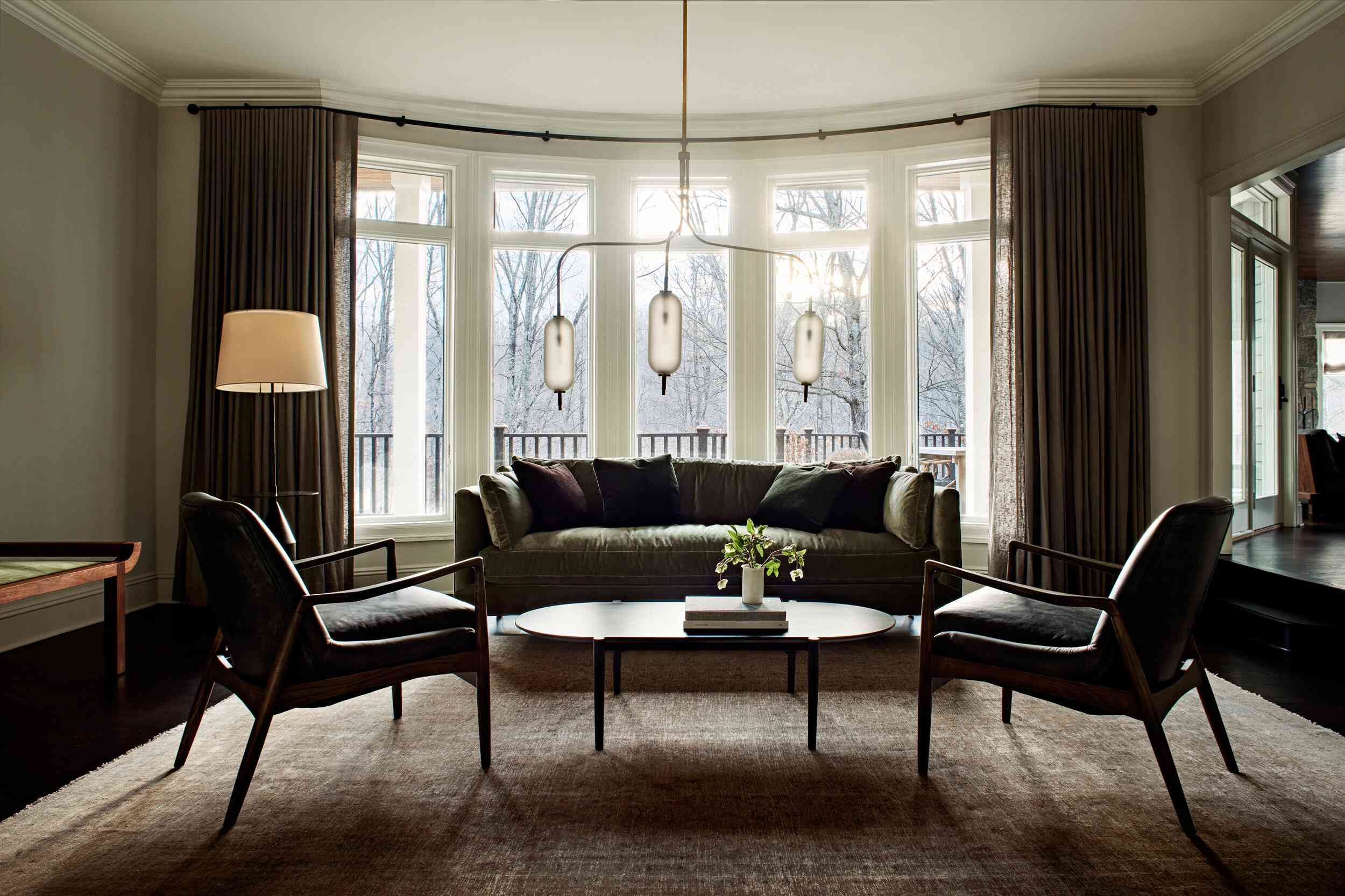 Bright but cozy living room with a velvet sofa