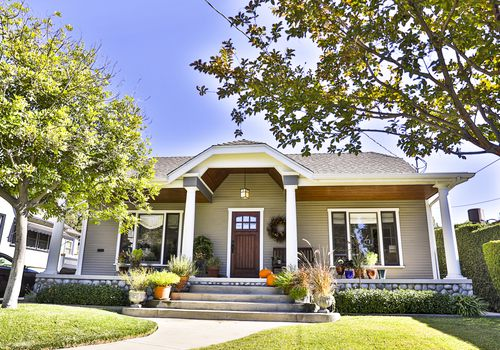 The front of a 1920s craftsman style on a sunny day