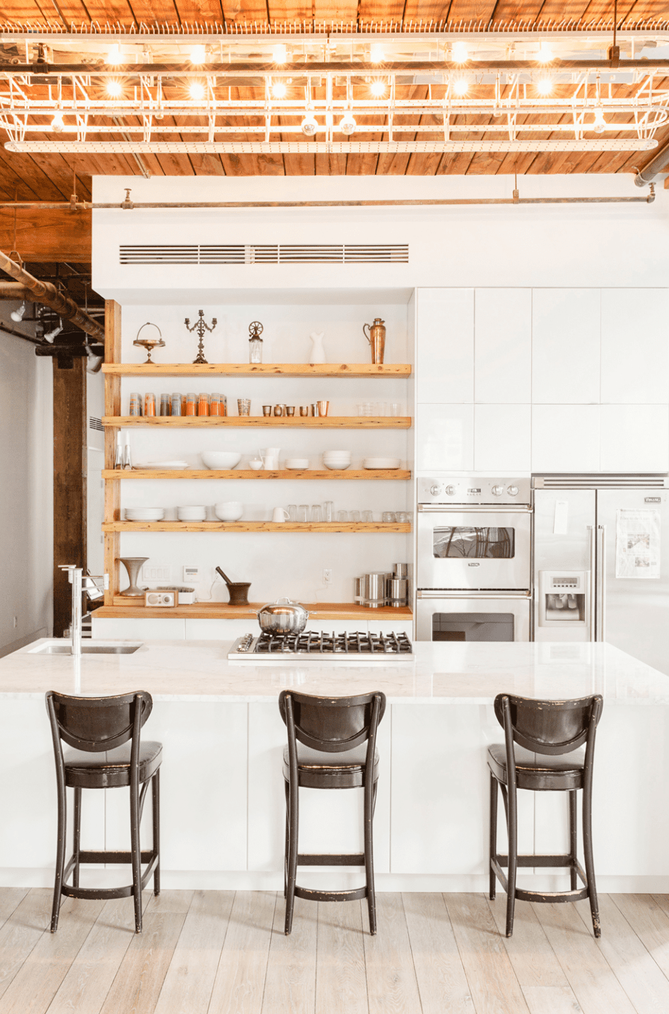 All white kitchen with exposed wood ceiling