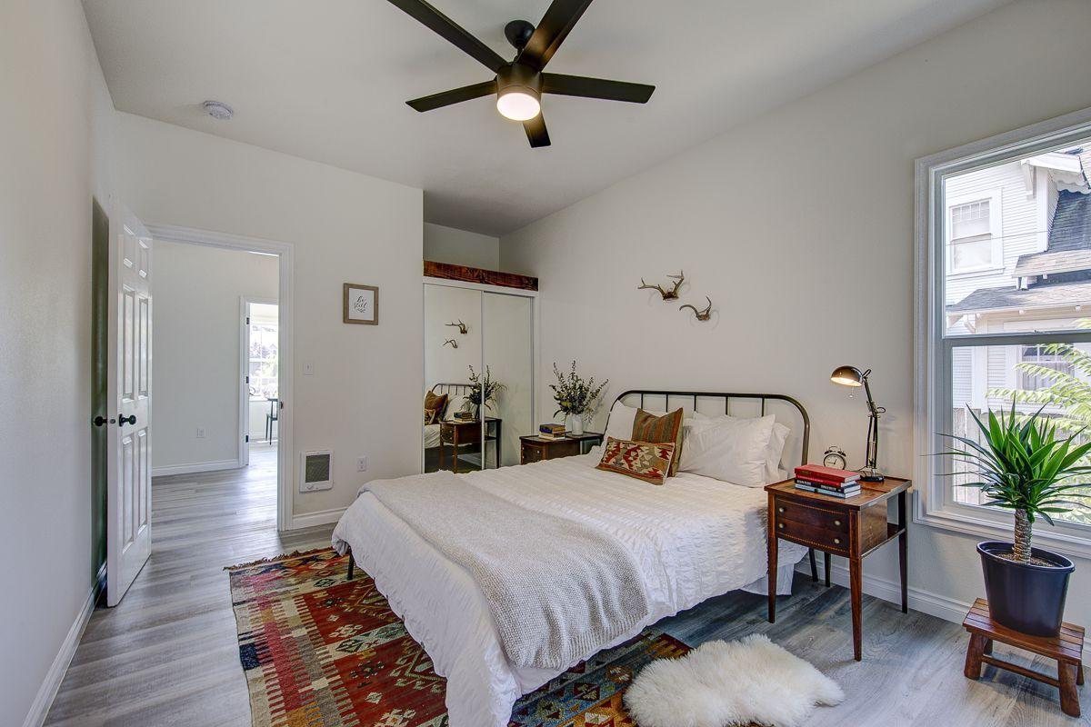 Midcentury bedroom with mirrored closet door.