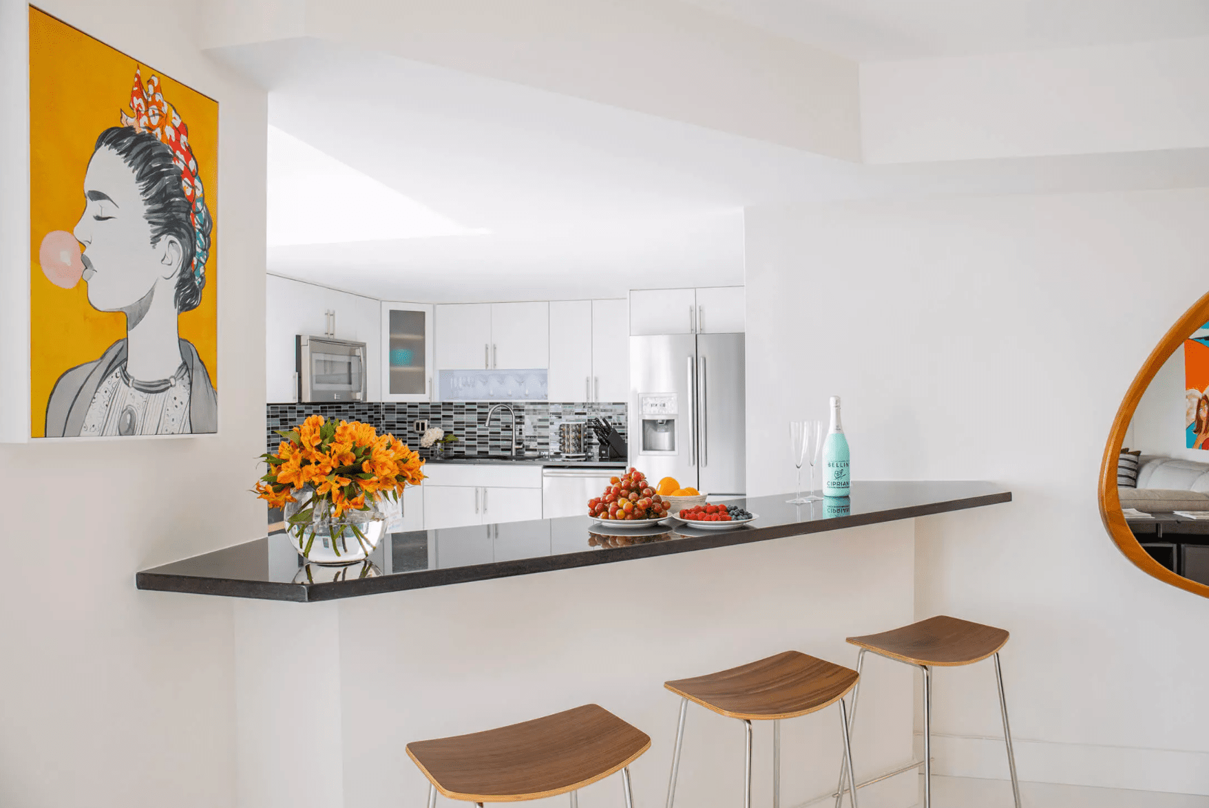 A kitchen with a diagonal built-in bar