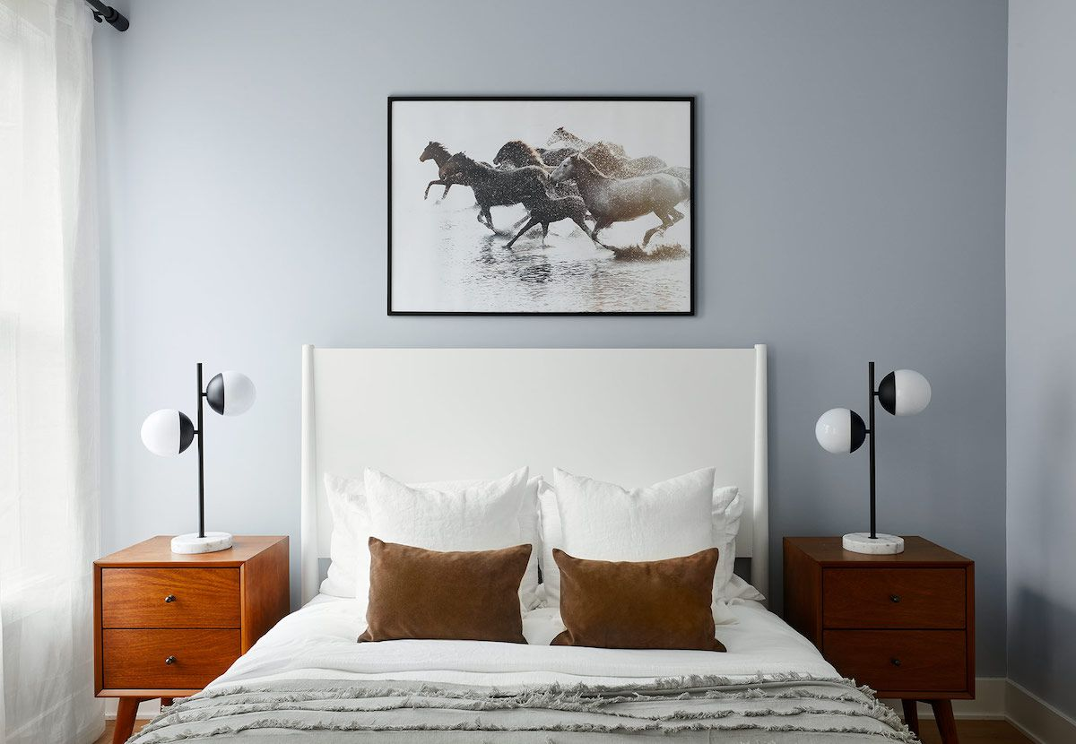 A modern rustic bedroom with two mid-century modern table lamps