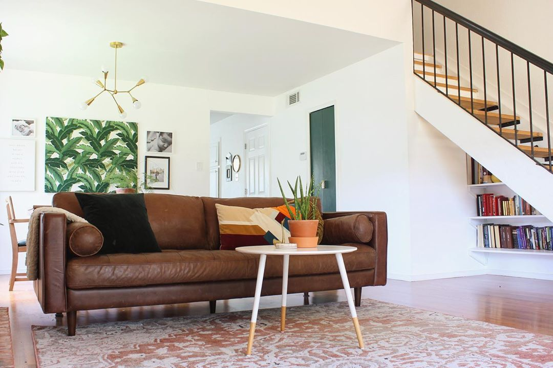 how to clean a leather couch - dark leather couch in simple white living room