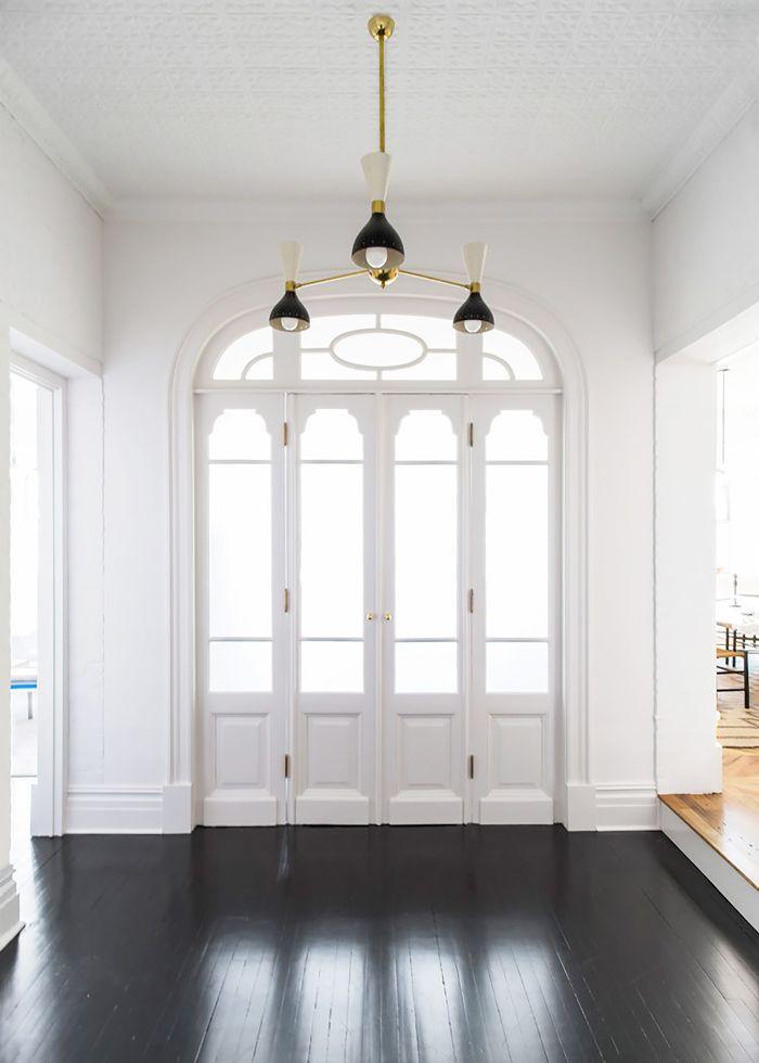 Glossy black hardwood floors in entryway