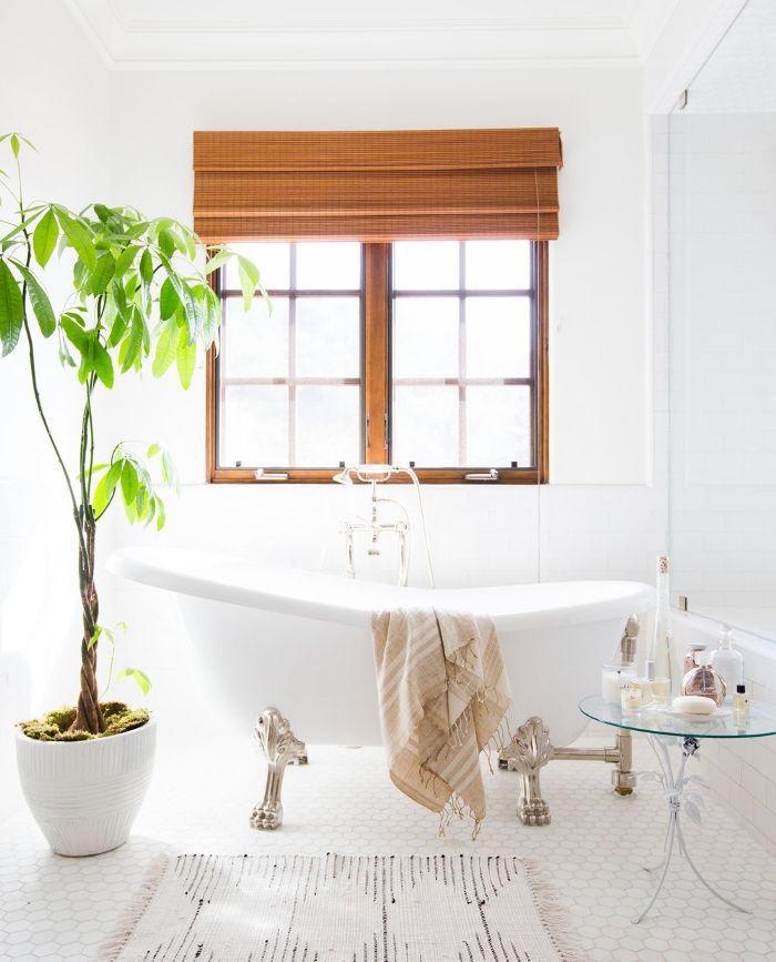 clawfoot bathtub in a bright rental bathroom