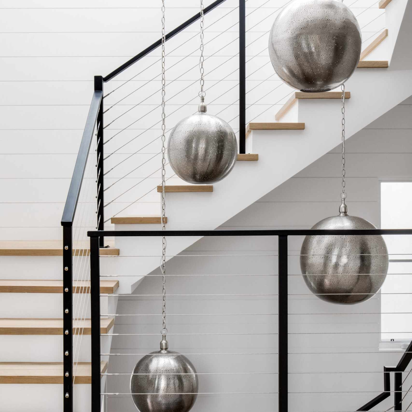 staircase with hanging lights
