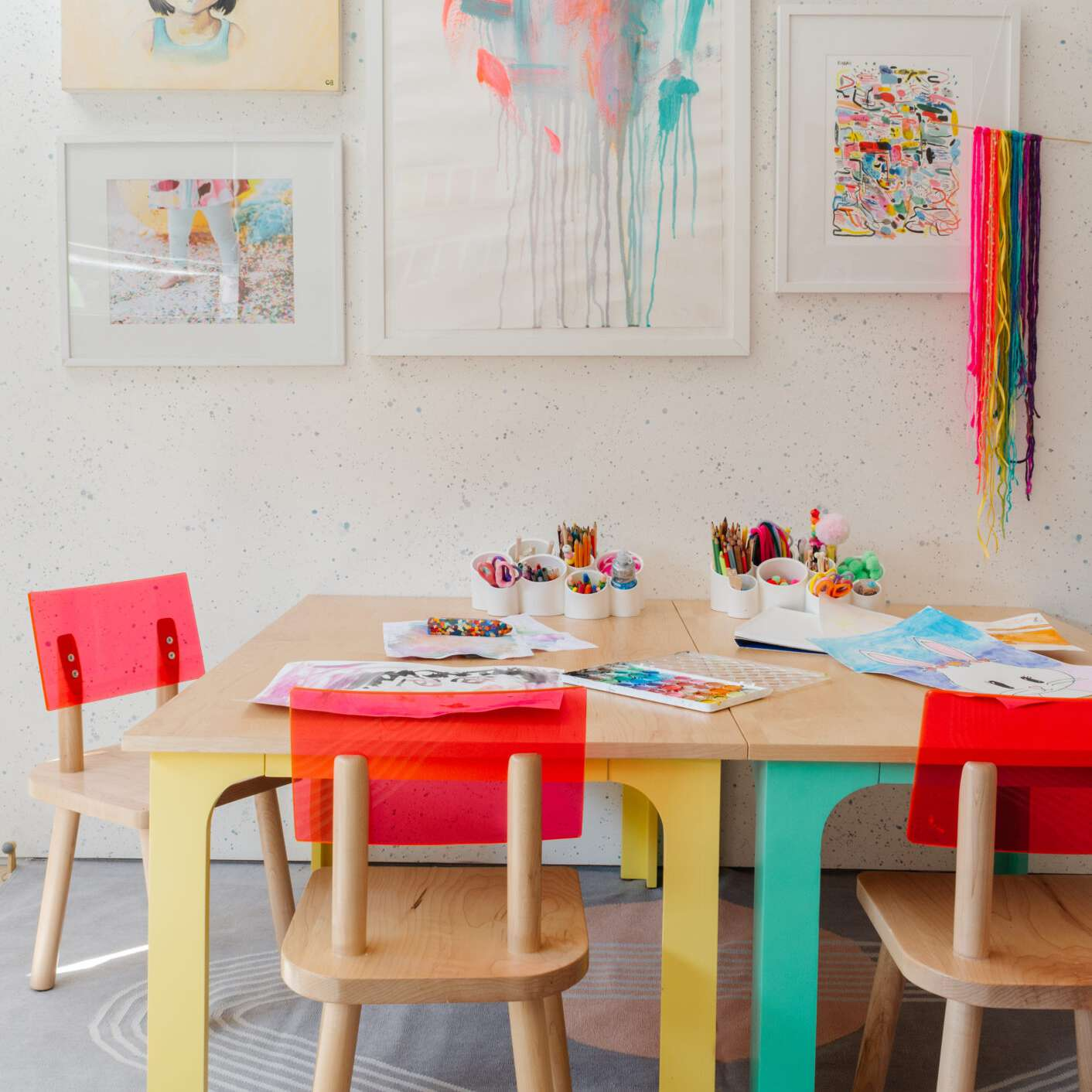 A kids' craft room filled with colorful chairs
