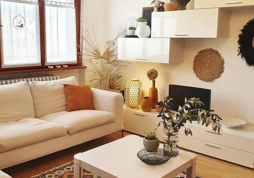 Scandi boho living room with floating white shelves.