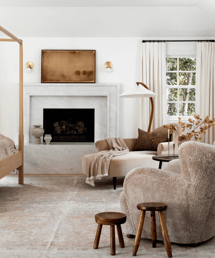 A bedroom filled with neutral lounge furniture