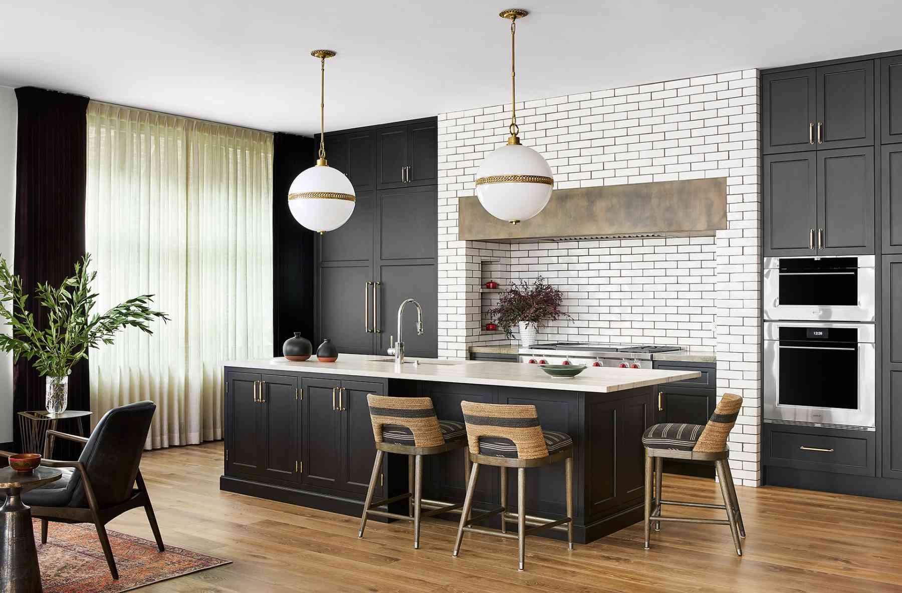 Minimalist kitchen with subway tile backsplash and brass hardware