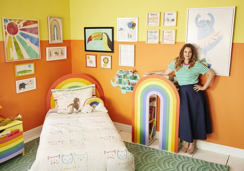 Drew Barrymore with her rainbow-themed collection of kids decor.