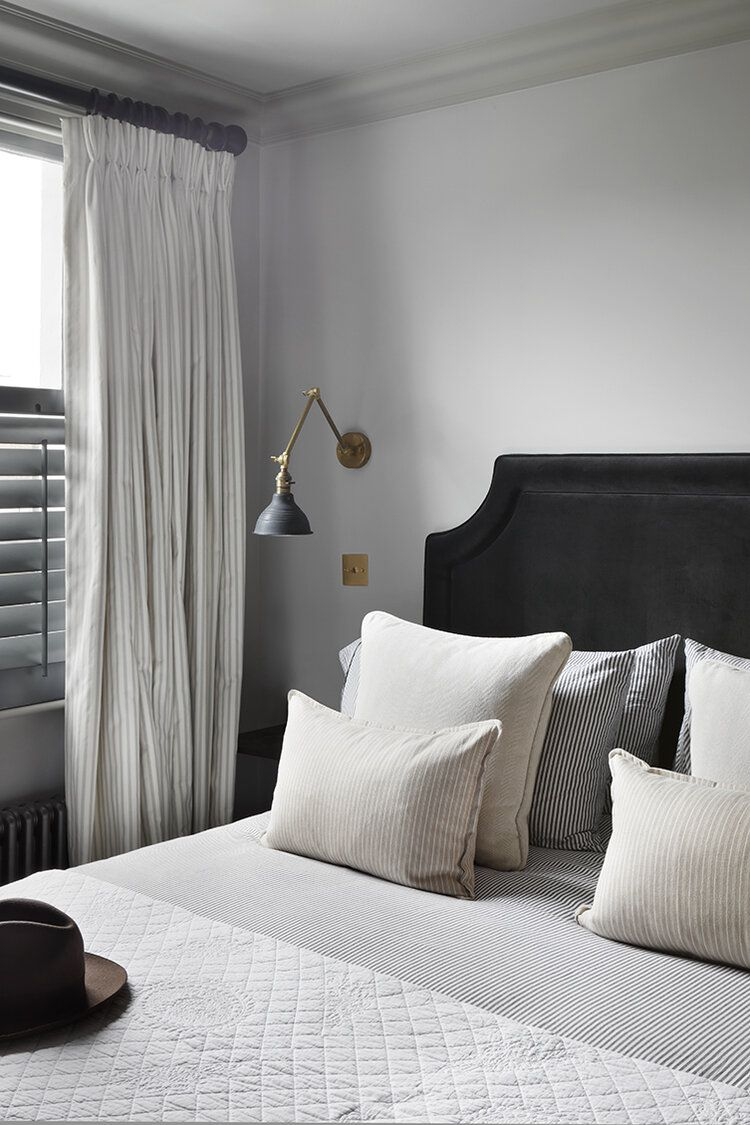 Close up of bedroom with drapes.