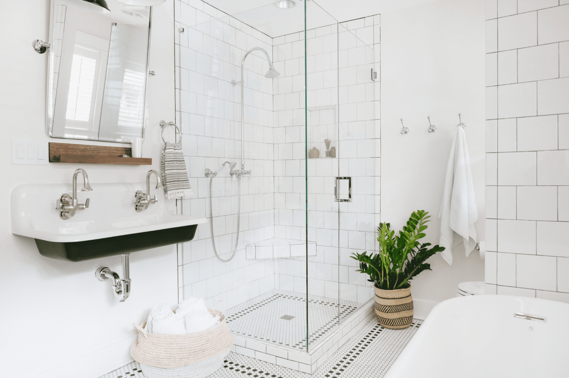 An all-white bathroom with a double sink