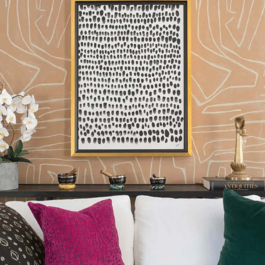 Printed wallpaper and colorful throw pillows in a living room