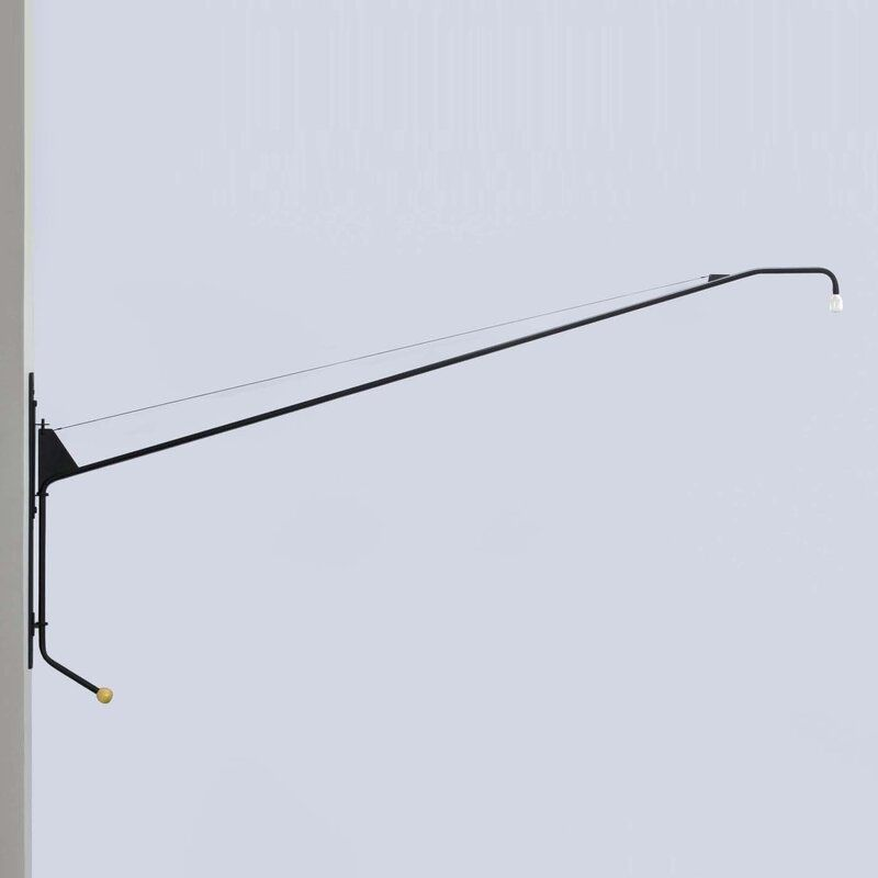 A black sconce with an extra-long arm, currently for sale at Wayfair