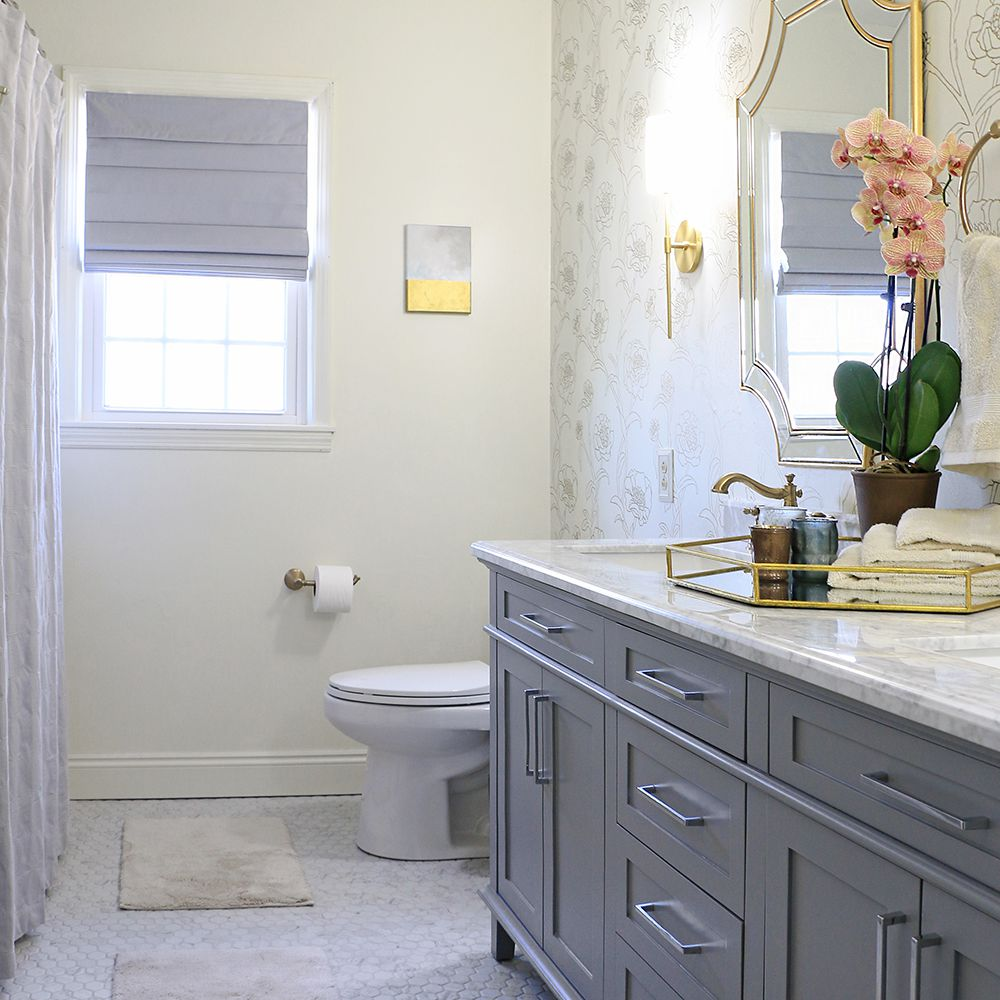 Hexagon-tiled bathroom with floral wallpaper