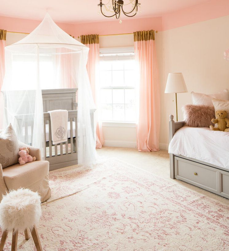 pink nursery with sheer canopy