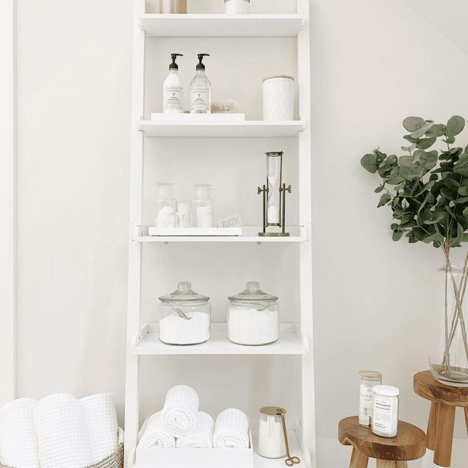 Open white shelf in bathroom.