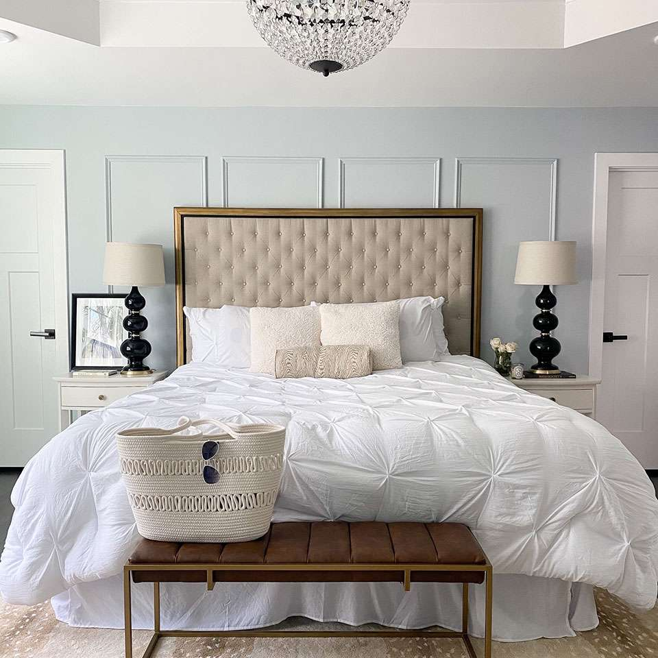 Parisian-inspired bedroom with powder blue accent wall.
