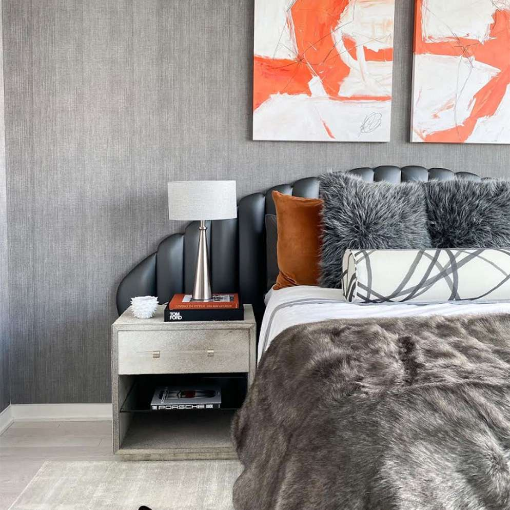 Chic gray and black bedroom with touches of orange