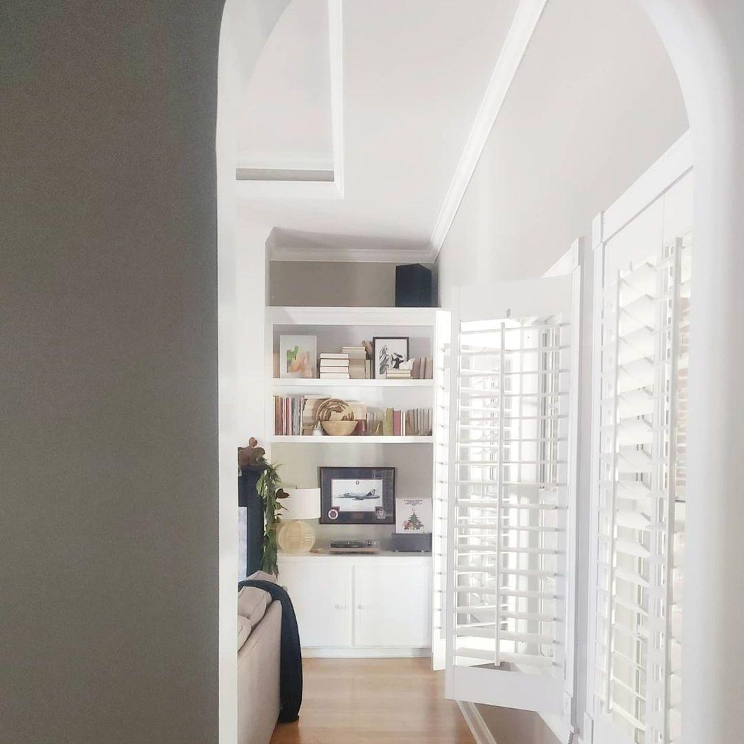 White blinds in white living room