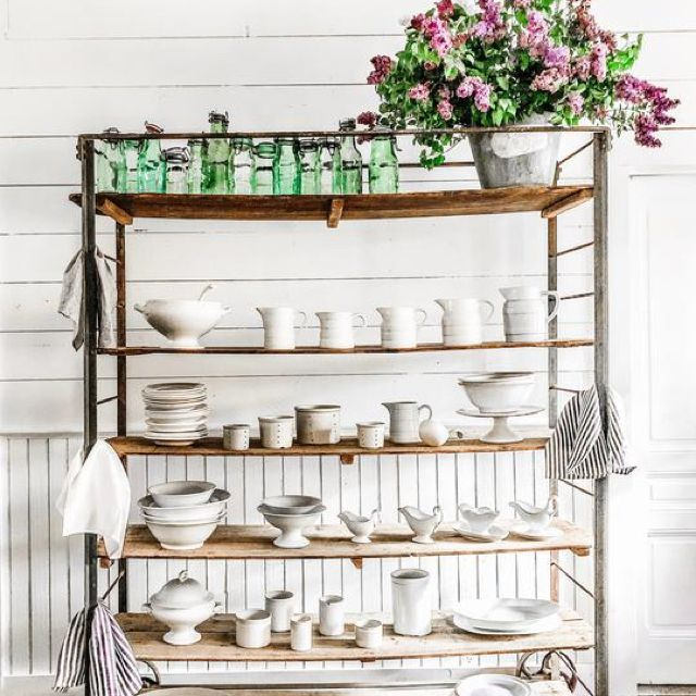 Vintage rack with a display of white ironstone serveware