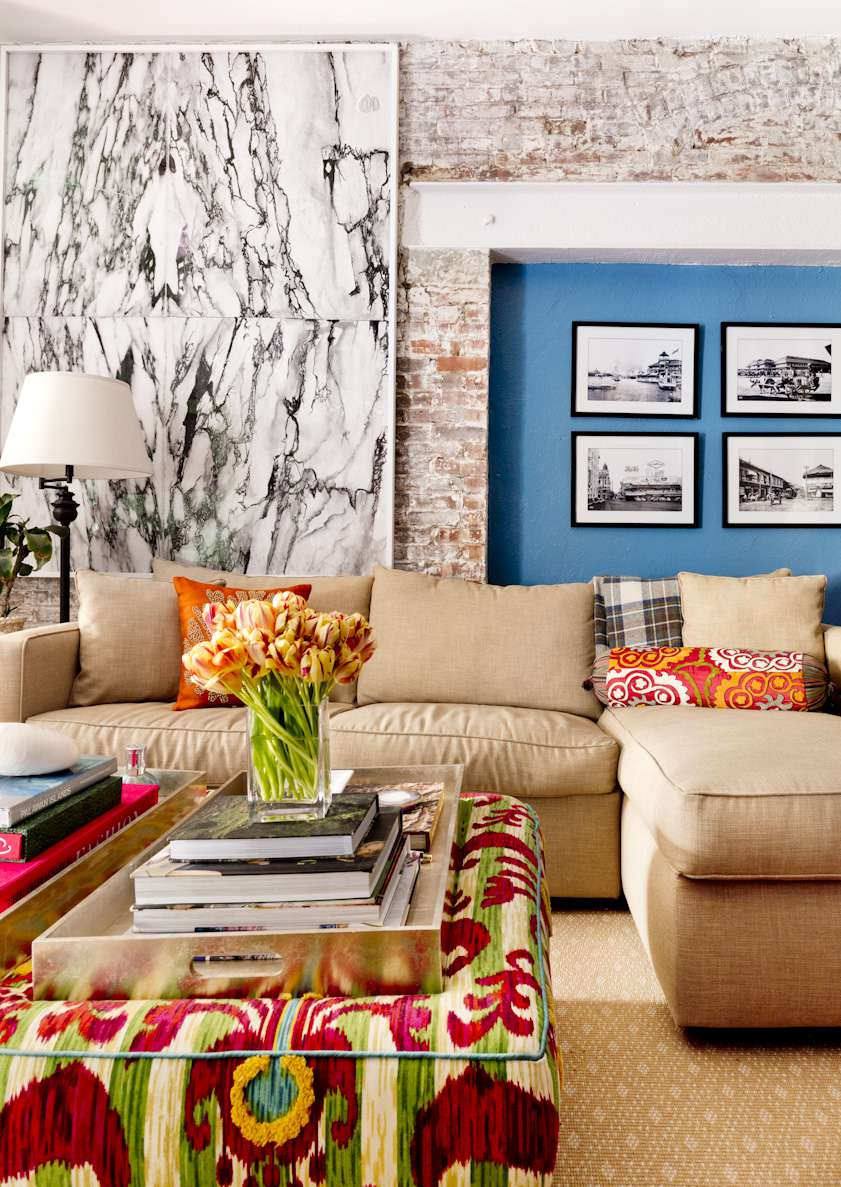 Boho-inspired living room with lived in furniture and patterned textiles