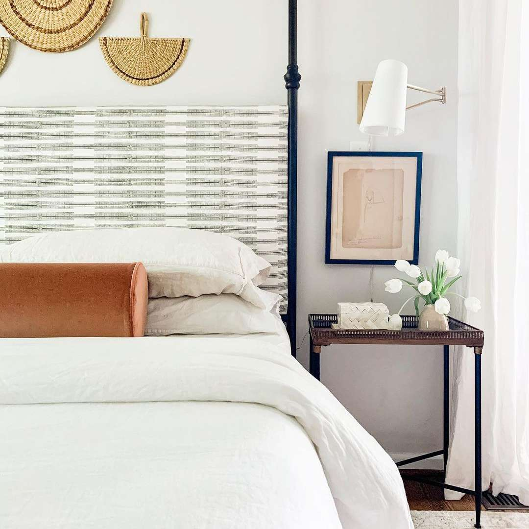 Costal bedroom with fan wall decor