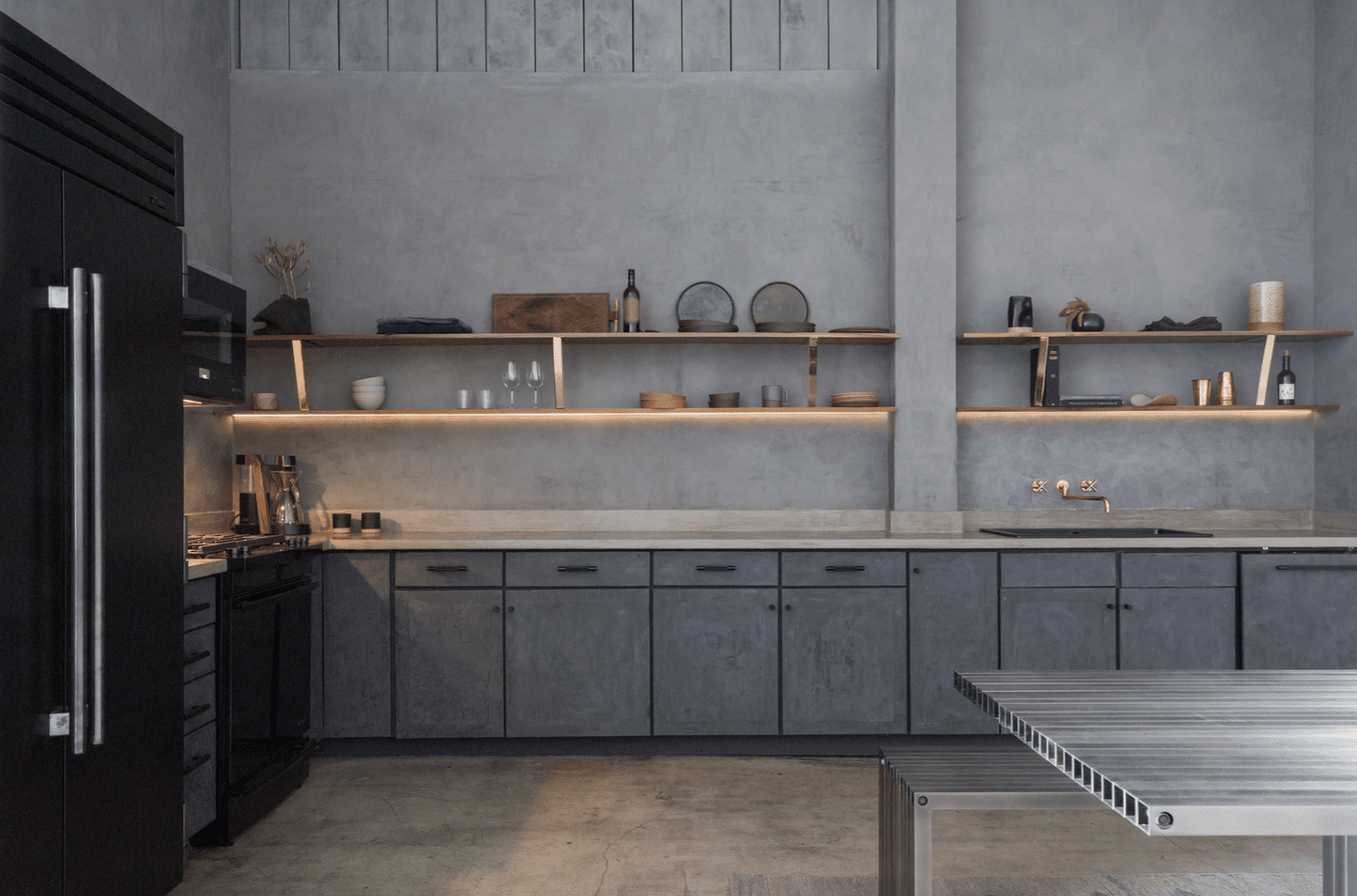 A kitchen lined with charcoal stone