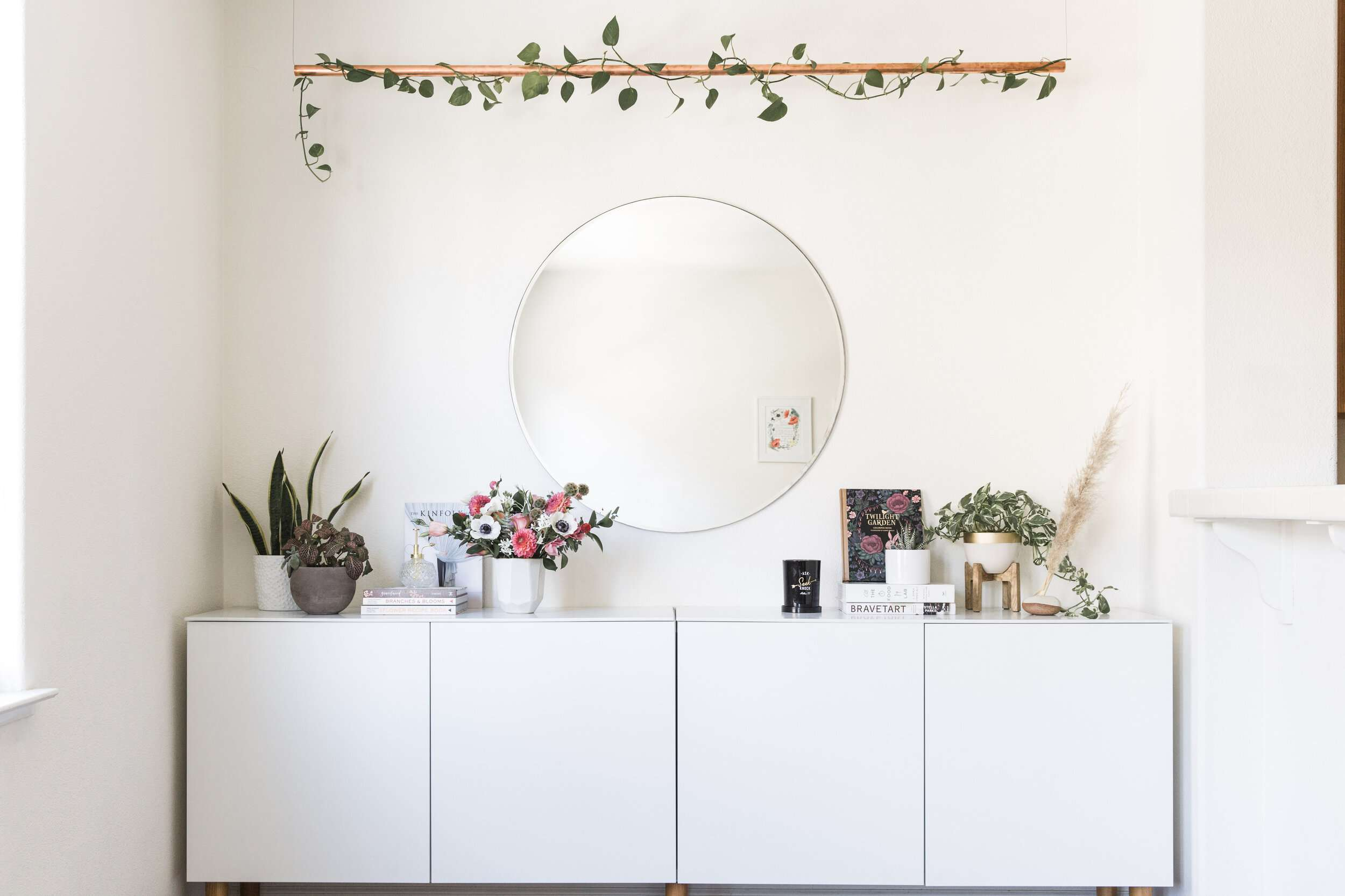 Dresser with plant vines above it