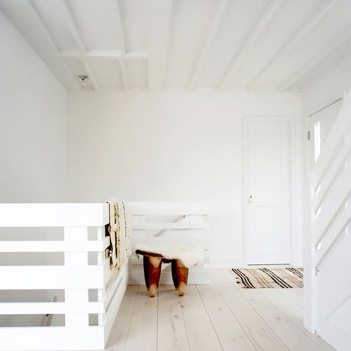 Whitewashed wide plank floors in hallway