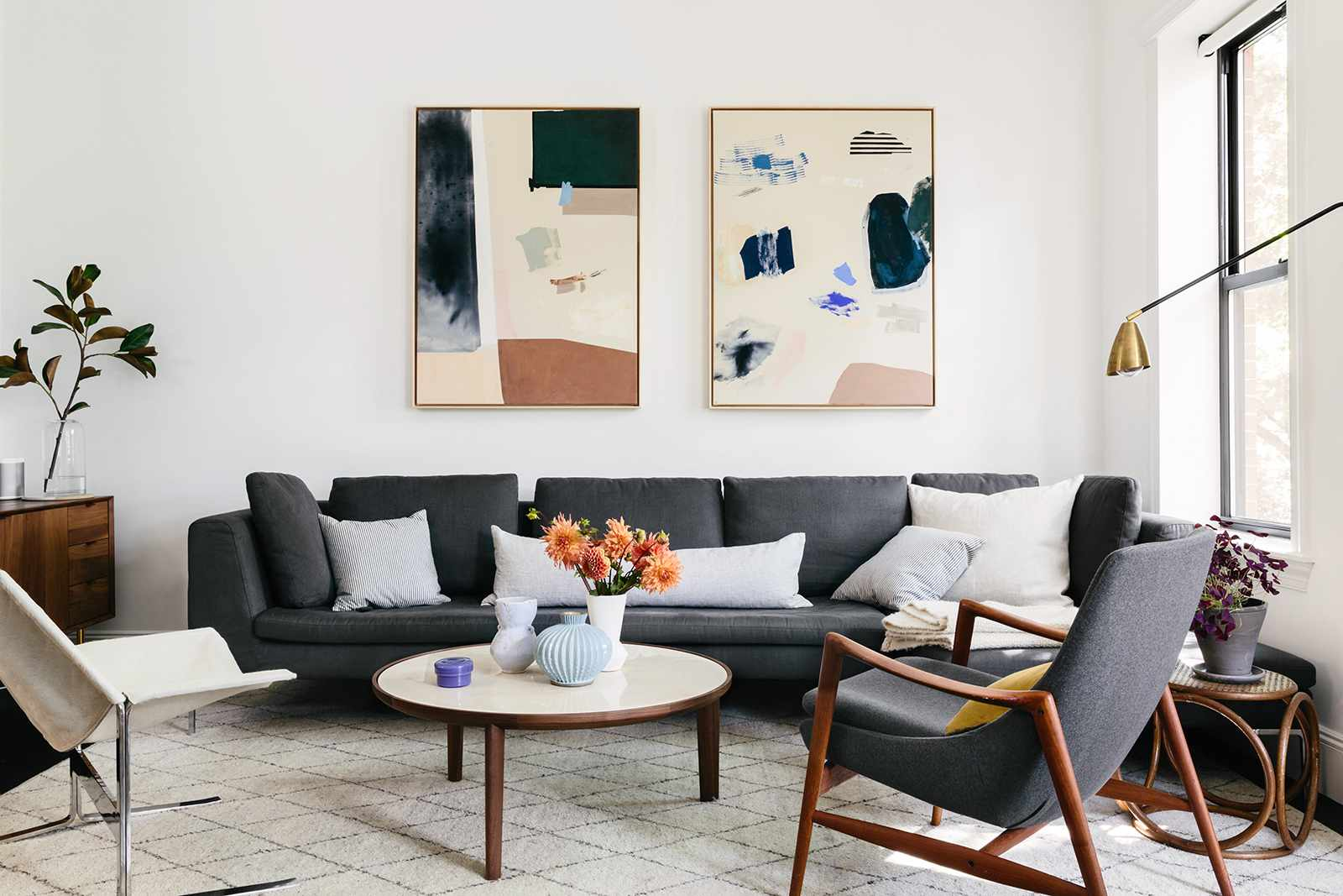 A living room with sleek midcentury modern furniture and contemporary abstract art