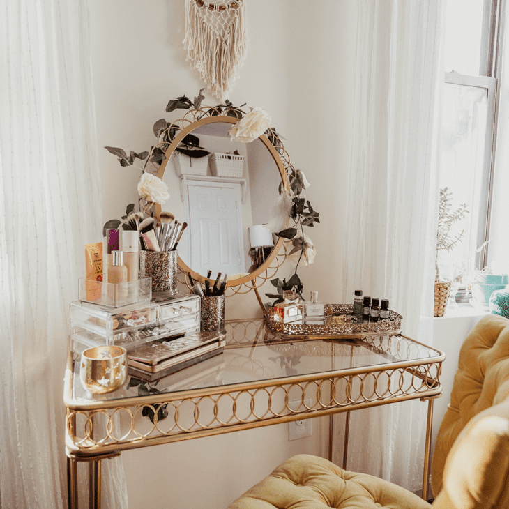 Gold vanity table with boho accents.