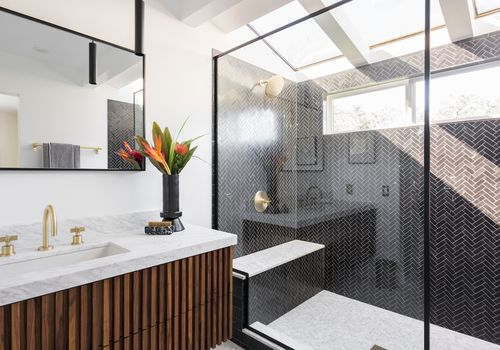 After bathroom with modern walk in shower.