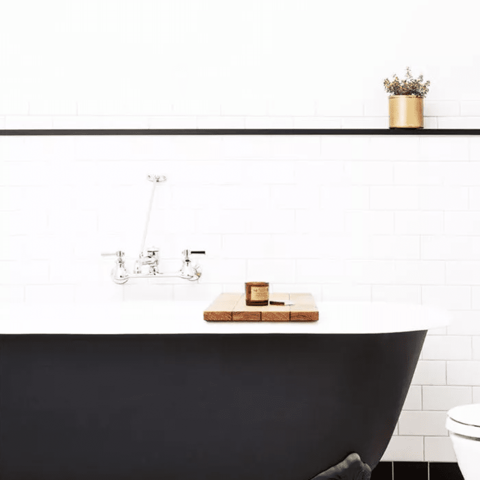 Black and white tiled bathroom with black claw-foot tub