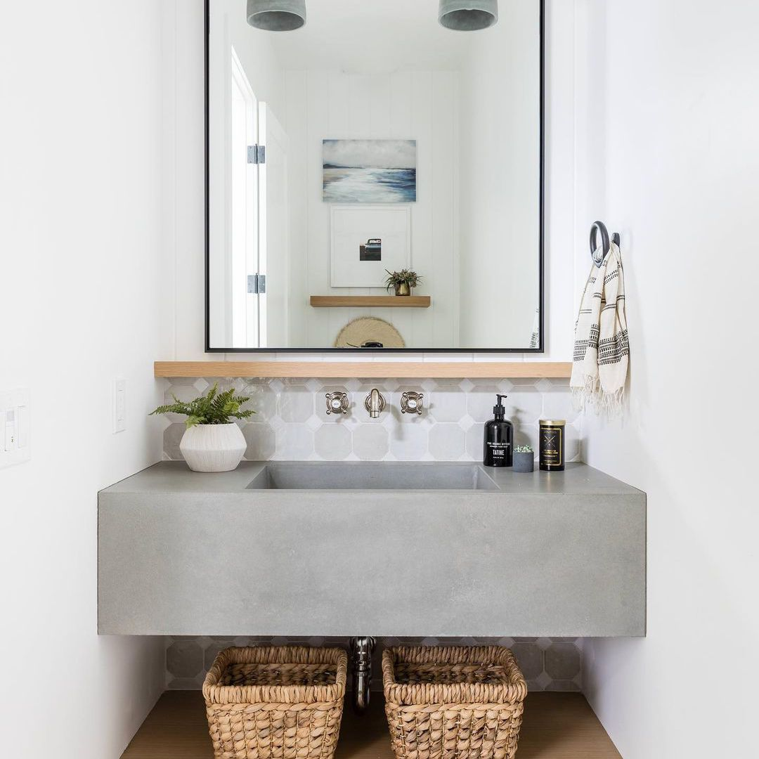 Bathroom with a cement sink