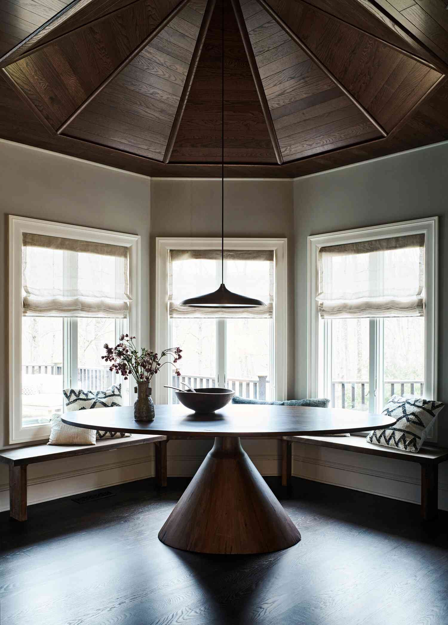 Dining nook with round wood ceiling