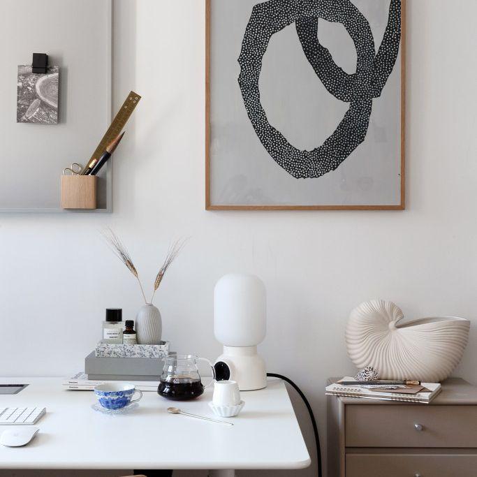 minimalist desk with artwork