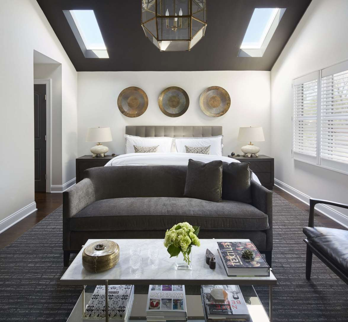 Sophisticated bedroom with gray ceiling and gray furniture