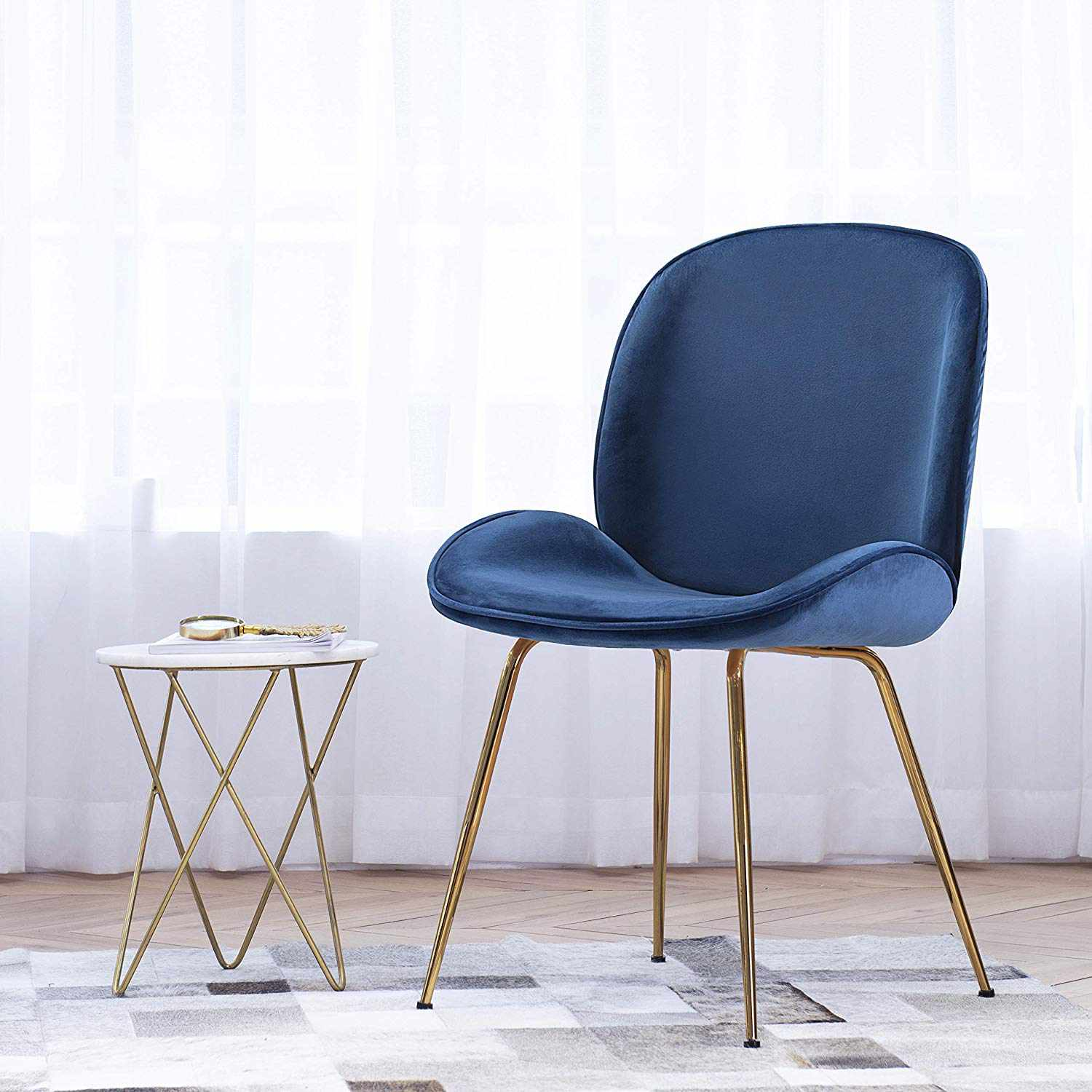 Velvet midcentury style blue chair with gold metal legs.