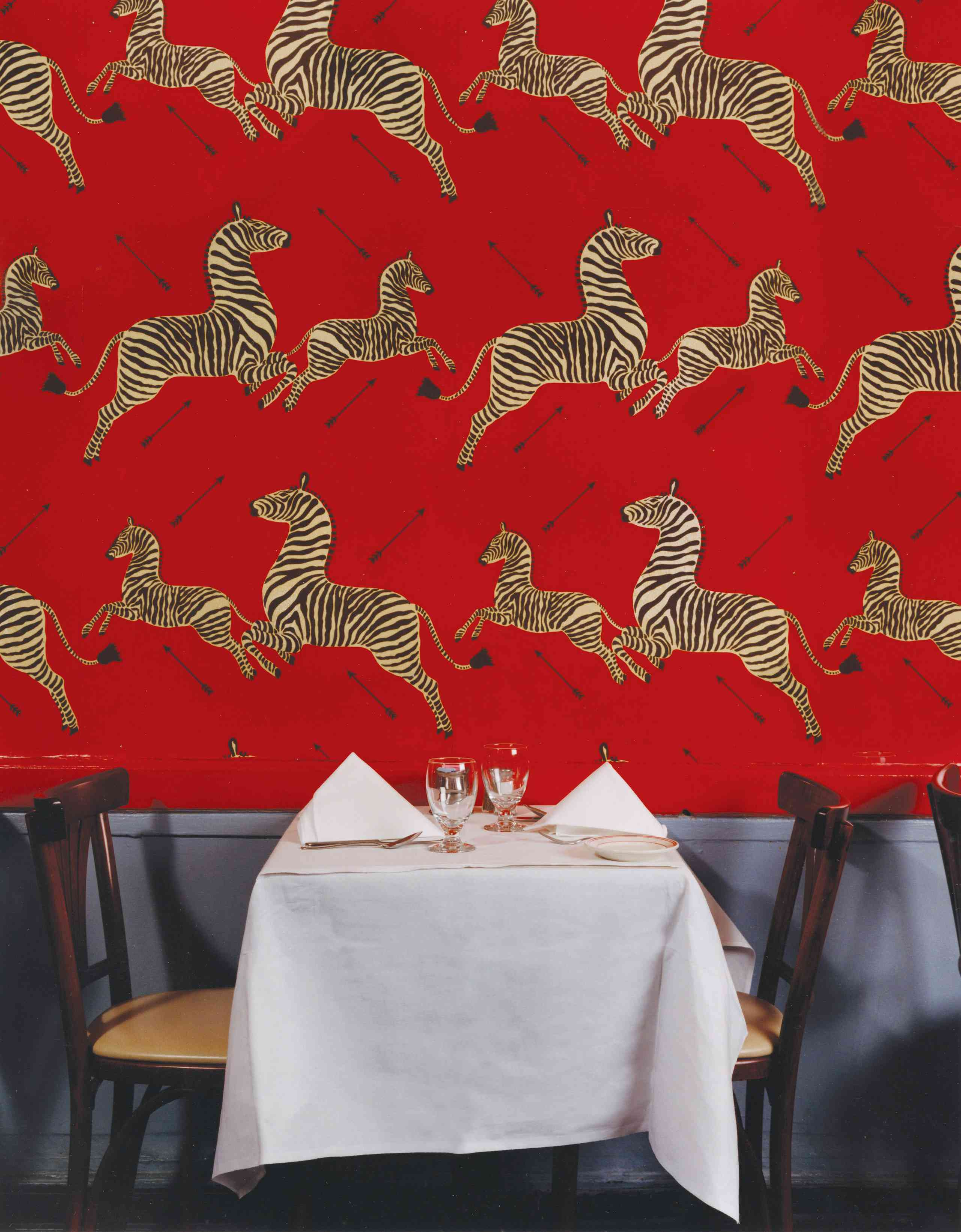 history of scalamandré zebras wallpaper - red wallpaper install in gino's restaurant