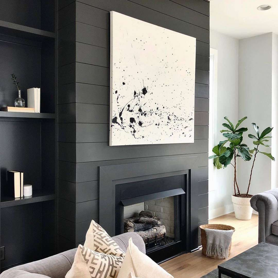 Fireplace with abstract art over it