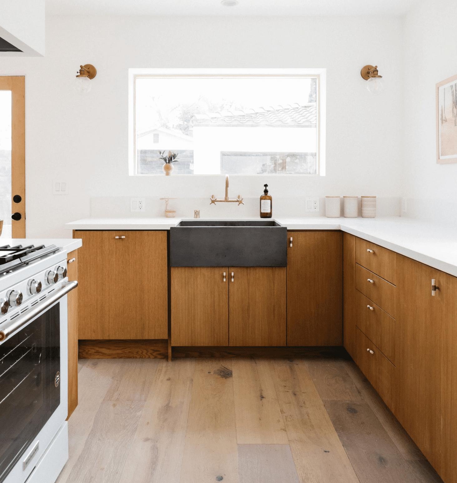 A kitchen with white walls and a matching white backsplash