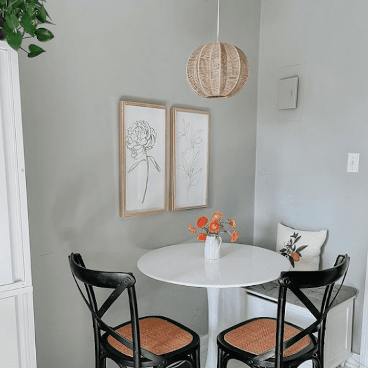 Minimalistic dining area with two chairs.
