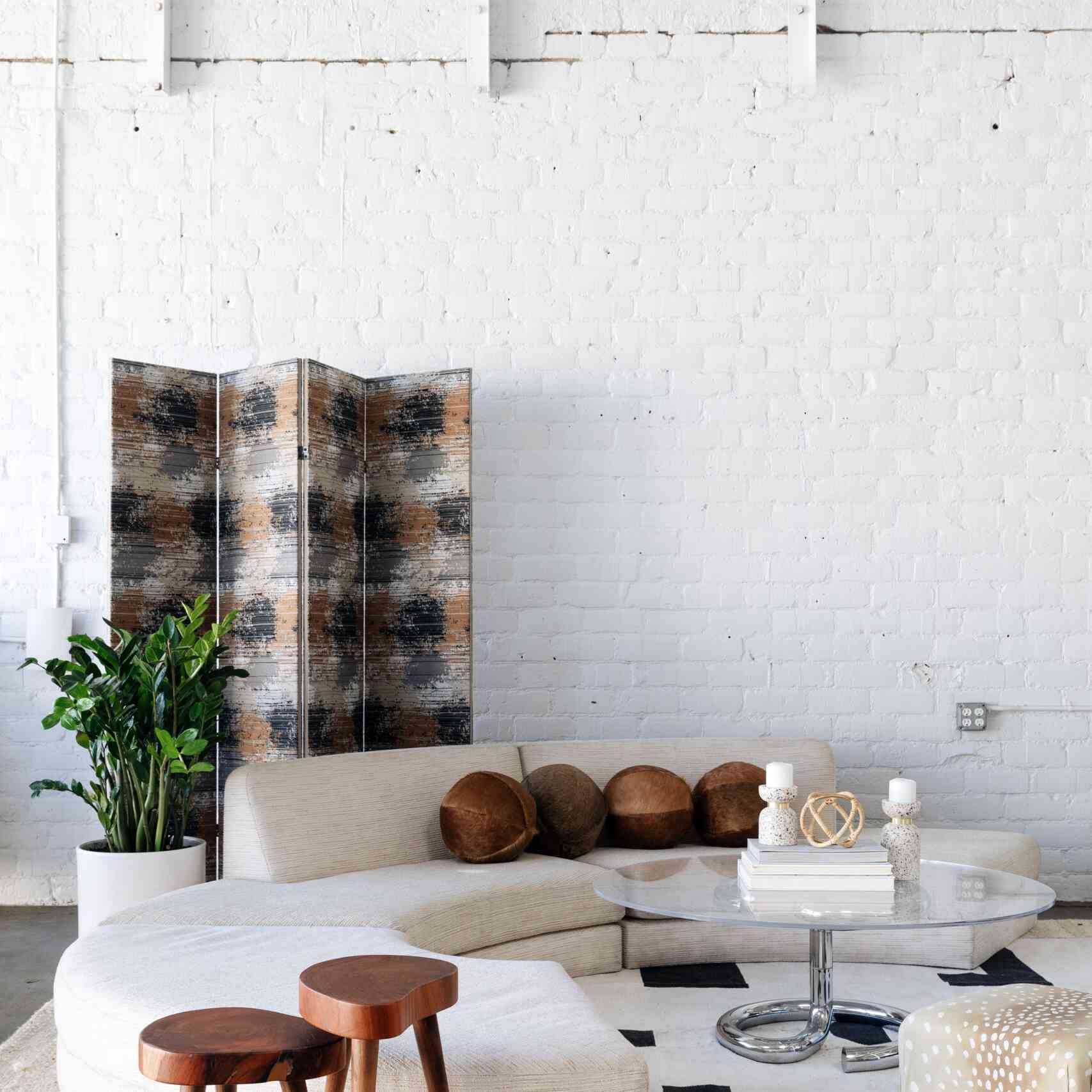 An industrial living room filled with industrial and earthy furniture