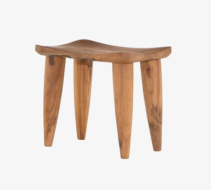 A teak bath stool, currently for sale at Pottery Barn
