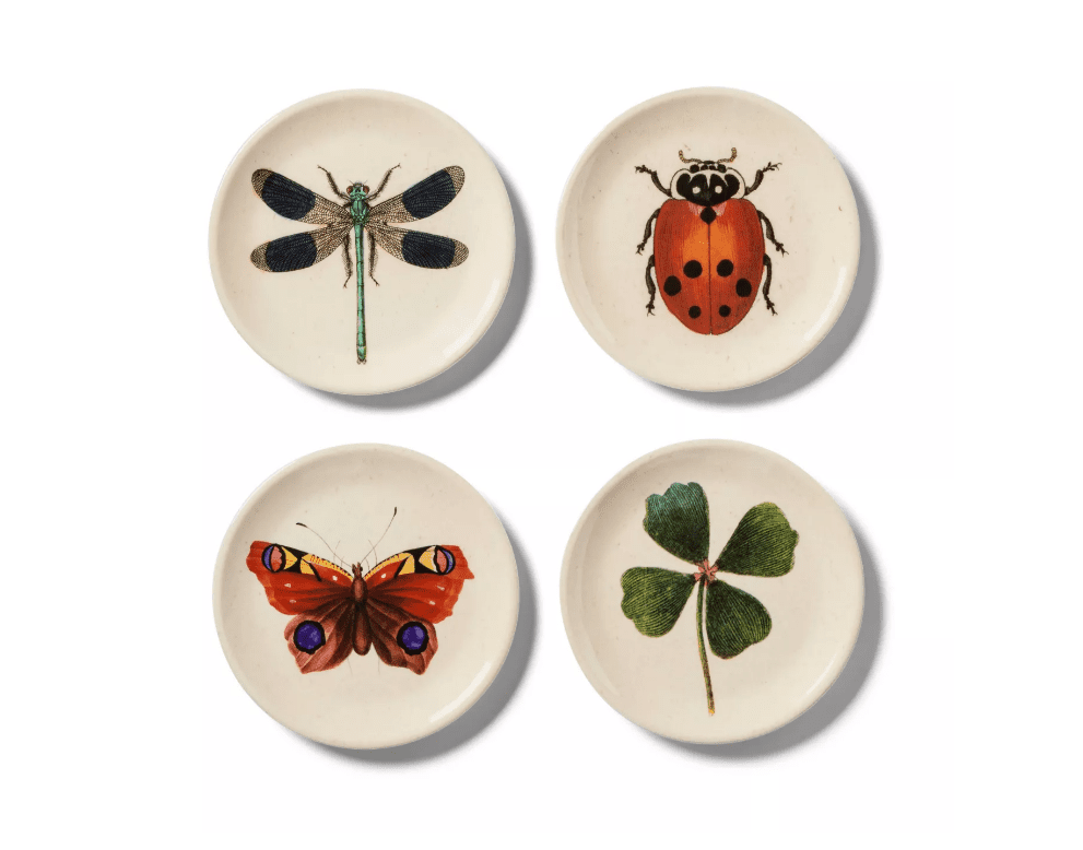 Set of four white melamine plates featuring a dragonfly, ladybug, butterfly, and four leaf clover.