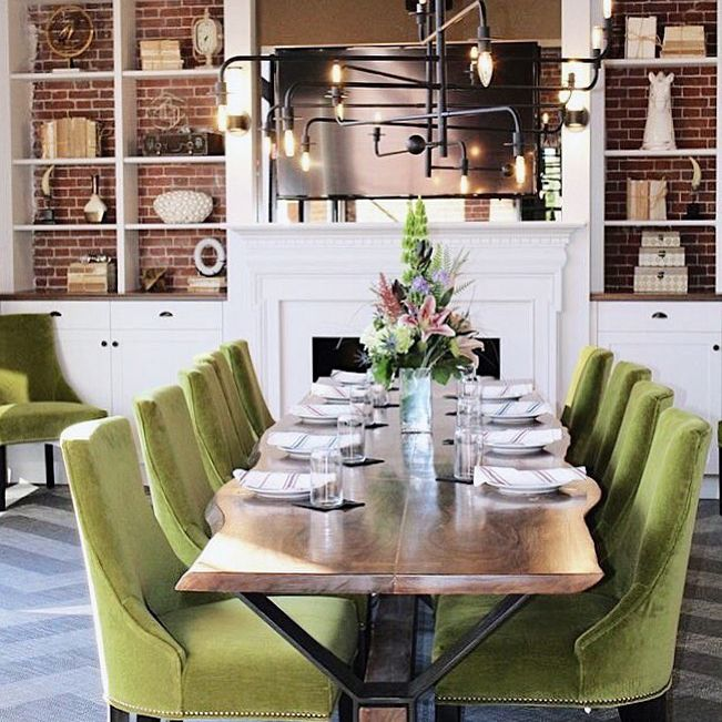 Dining table with green chairs.