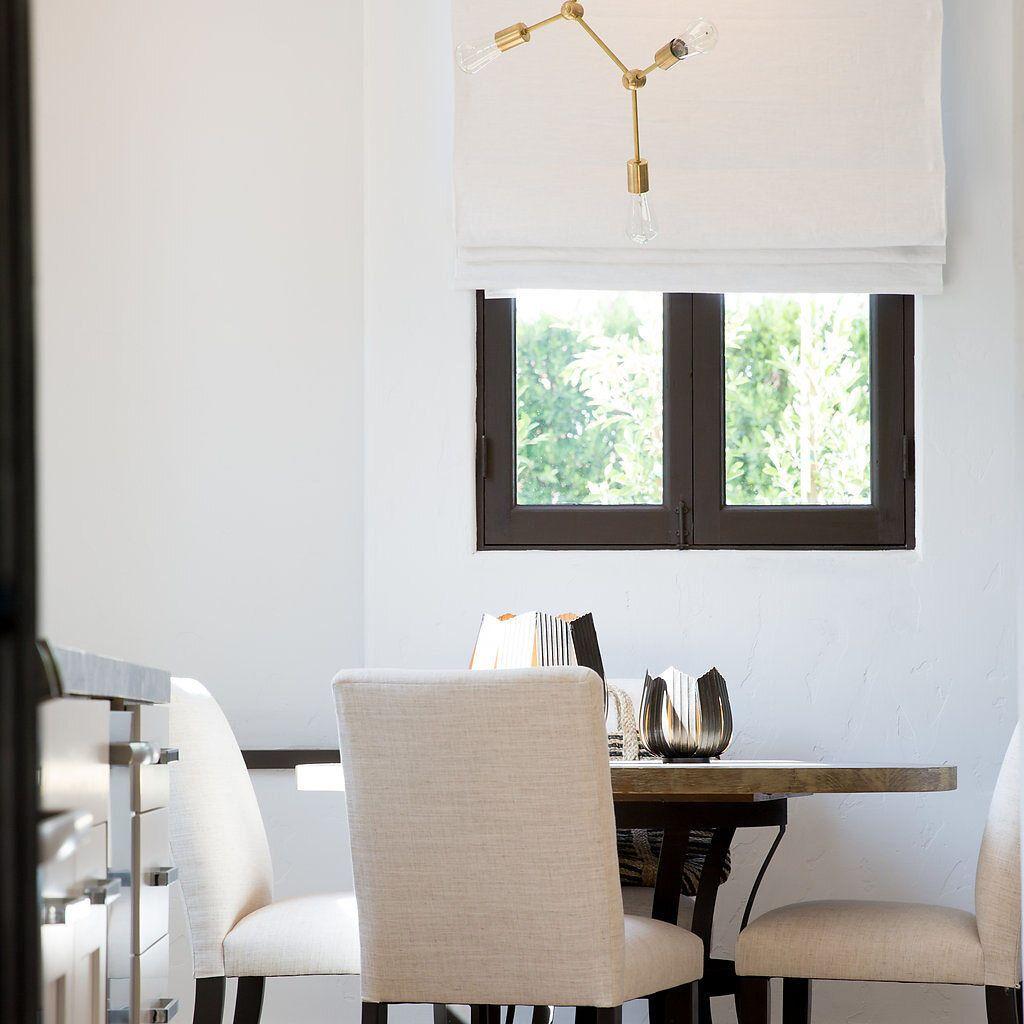 Modern dining area with minimal sputnik chandelier